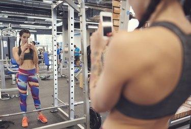 Sports woman taking selfie in fitness club