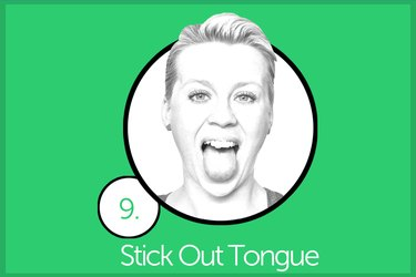 Woman performing stick out tongue exercise.