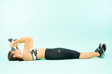 woman doing lying triceps extensions