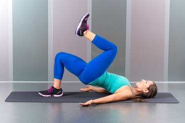 Woman performing a single-leg glute bridge