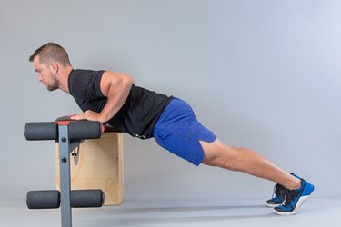 Man performing burpee modification for knee pain.