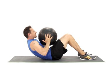 Man doing a weighted crunch to work his abs.