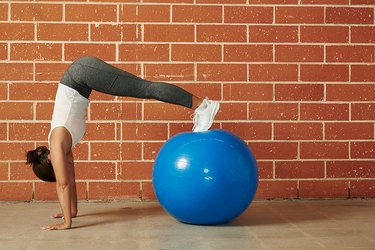 woman doing a stability ball workout