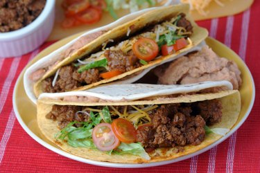 ground beef tacos with tomato and lettuce