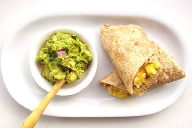 Healthy snack mini egg burrito with guacamole
