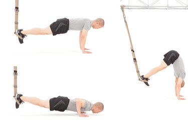 Man performing atomic pike push-up on the TRX Suspension Trainer