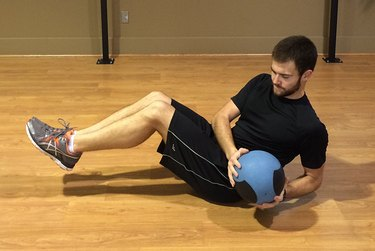 Medicine balls are just one of many tools that kick up your abs workout.