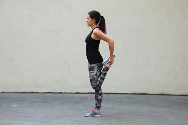 Woman Doing Quadriceps Stretch to Strengthen Knees