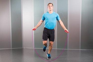 Man Demonstrating How to Do Single-Leg Jumps