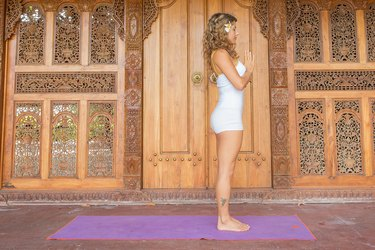 Your sun salutation journey begins and ends with tadasana.