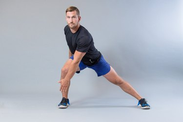 Man performing lateral lunge modification for knee pain