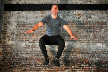 man doing a jump squat