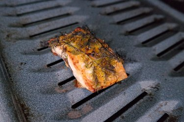 Broiled salmon in the oven on a broiler tray