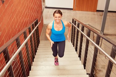 Woman Running Stairs in Her Hotel
