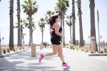 Stacy runs on the boardwalk.
