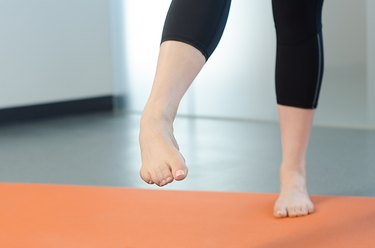 Woman performing Write the Alphabet exercise for foot pain