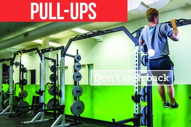 Man doing pull-ups with proper form to prevent back pain