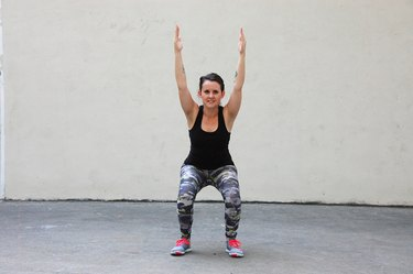 Woman Doing Overhead Squat Assessment for Knee Pain