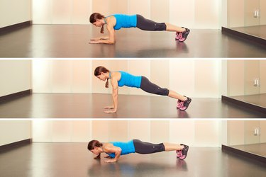 Woman Demonstrating Plank to Push-Up in Her Hotel Room