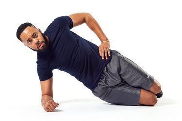man doing a modified side plank