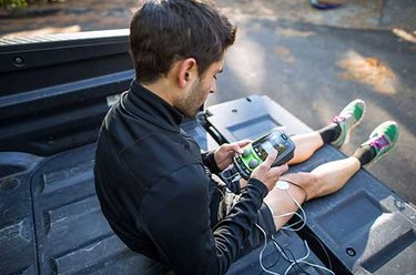 Man using Marc Pro in the bed of his truck after a workout