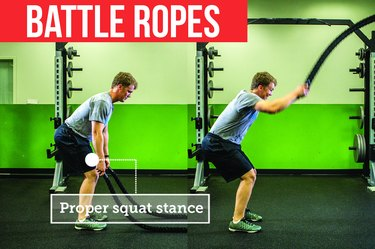 Man using battle ropes  with proper form to prevent back pain