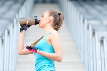 woman drinks protein powder after workout