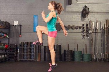 woman doing a single-leg jump squat