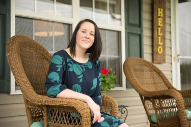 Lacey smiles on her porch.