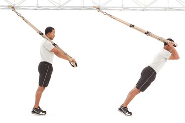 Man performing triceps press on the TRX Suspension Trainer