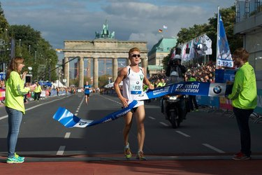 Person crossing the finish line at the Berlin Marathon