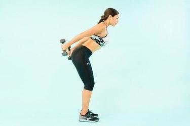 woman doing triceps kickbacks