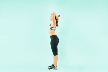 woman doing overhead triceps extensions