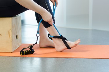 Woman performing foot exercise for foot pain