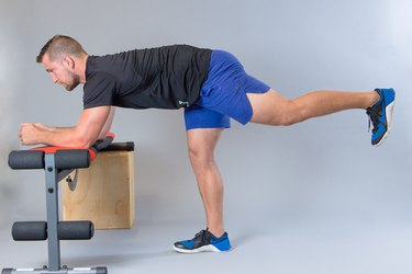 Man performing glute kickback  modification for knee pain