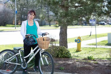 Mindy stands with her bike.