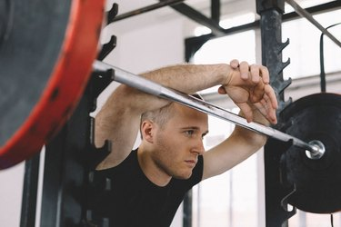 Athletic Men Workout With Kettle Bell