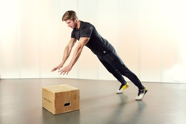 Man Demonstrating How to Do an Incline Power Push-Up