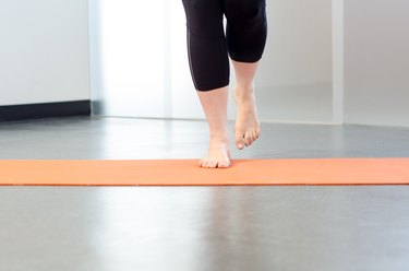 Woman performing multi-directional single-leg hops for foot pain
