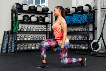 woman doing a lunge jump