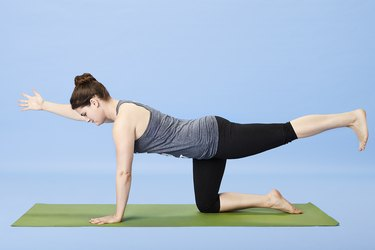 Woman performing bird-dog for back pain