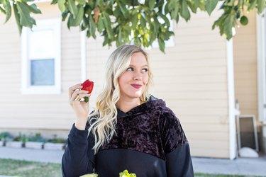 Danika Brysha eating a snack outside