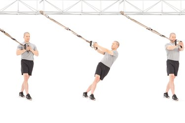 Man performing resisted torso rotation on the TRX Suspension Trainer
