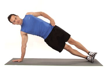 Man doing a side plank to work his abs.