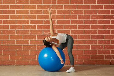 woman stretching with a stability ball