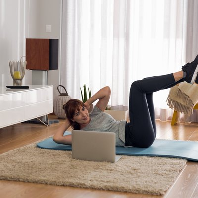 Woman doing video workout at home