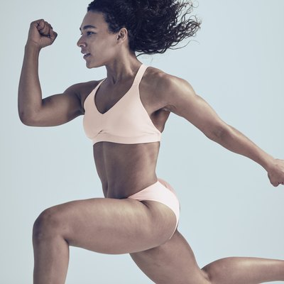 woman running in the athleta bra