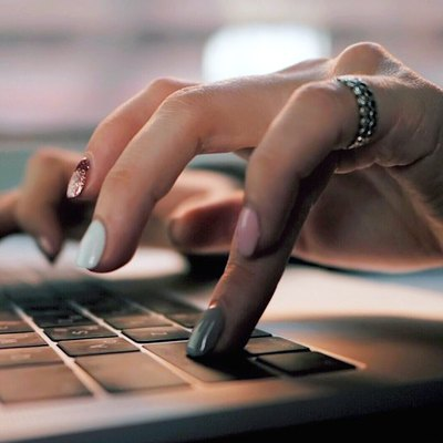 woman doing work at computer