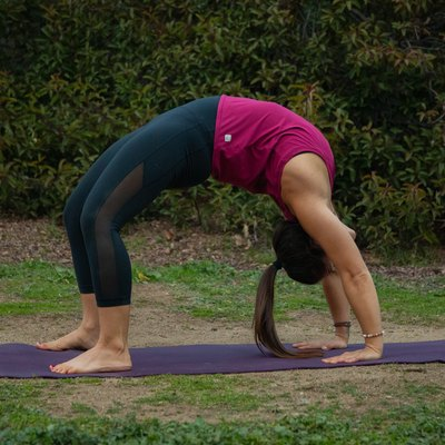 Woman performing backbend.