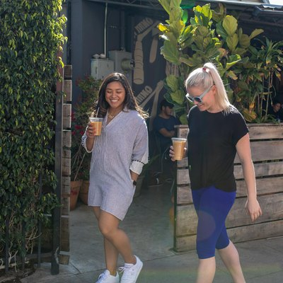 two women walking to get coffee and participating in the 10,000 steps a day challege